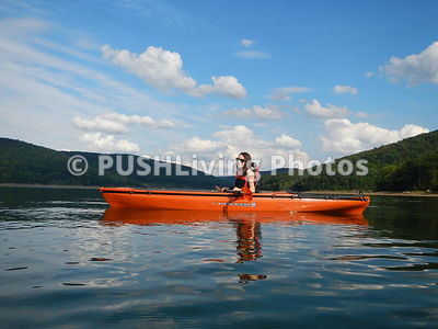 Young woman in her adaptive kayak