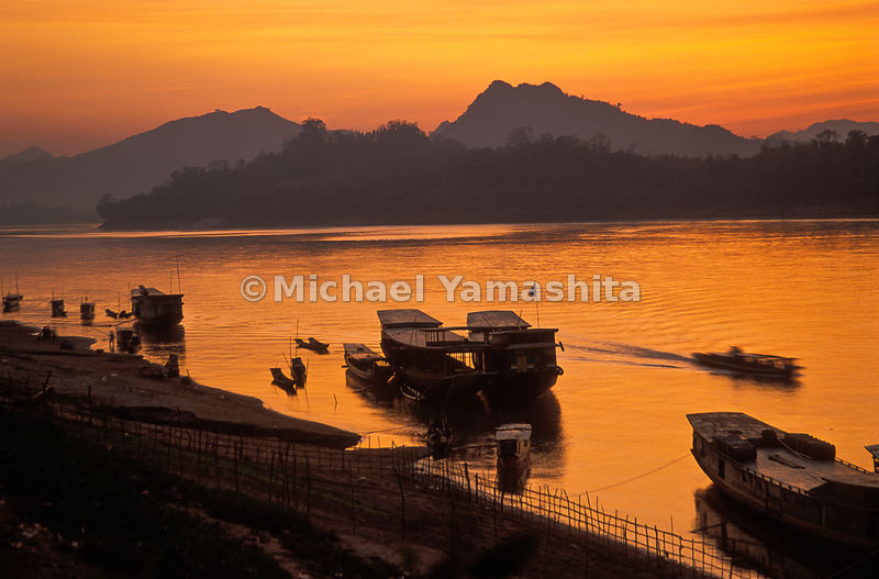 Boats on the shores of the Mekong River, Laos