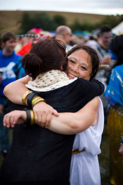 UK - Standon - Two women greet each other with a hug at the Standon Calling Festival