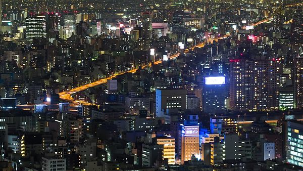Bird's Eye: Close Shot Of Flickering Buildings & Highways Looping Through the Density of Tokyo at Night