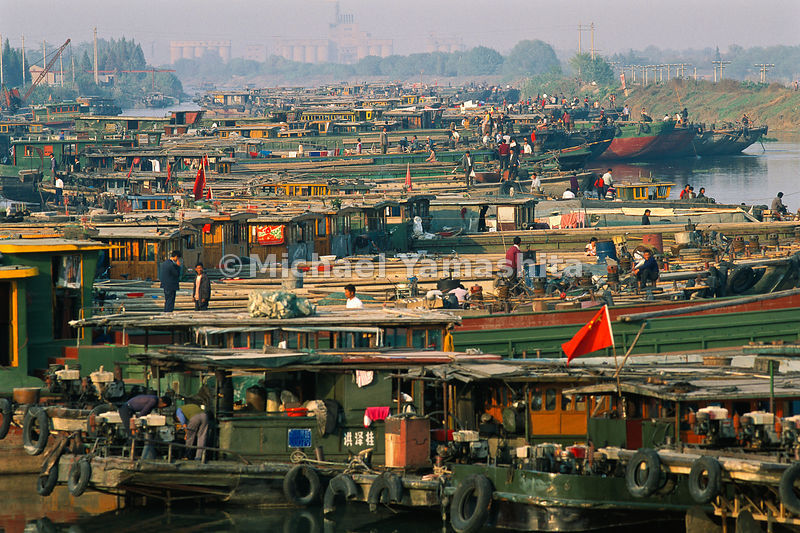Hundreds of boats create an immense traffic jam on the Grand Canal in Yangzhou.