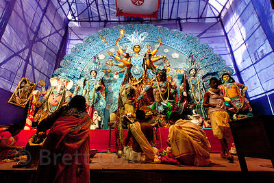 A Durga Puja pandal in Sovabazar, Kolkata, India. On the walls are hundreds of dolls.