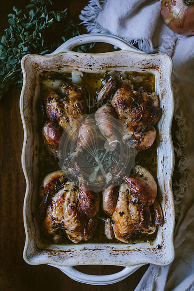 4 Cuban Roasted Game Hens are photographed right after they came out of the oven.