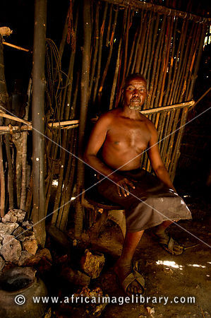Akamba man at his hut, Ngomongo Village, Kenya