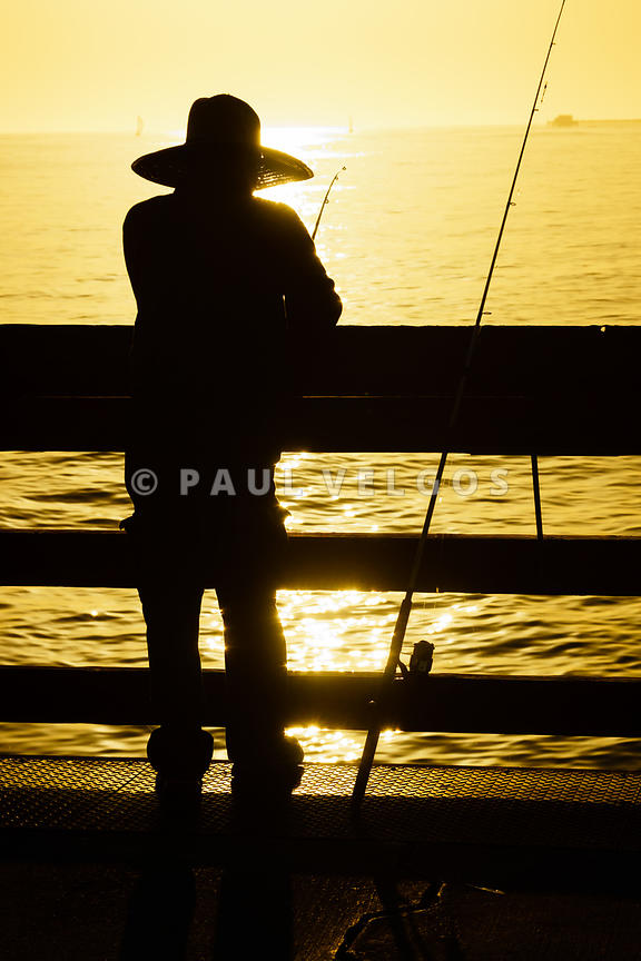 Balboa Pier Fisherman Fishing in Newport Beach California