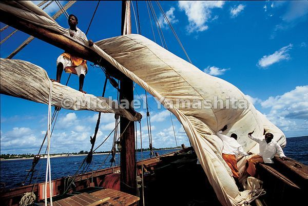The Sanjeeda, one of the last great sailing dhows, navigates the waters off the coast of Lamu.