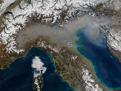 EARTH The Alps -- 17 Mar 2005 -- A grey veil of haze covers the Po River Valley of northern Italy and stretches out over the ...