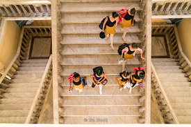 Students descending a staircase at the Cuban National Ballet School in Havana, Cuba.  There are approximately 3,000 students ...