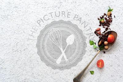 A spoonful of black rice salad on a textured white background. Copy space.