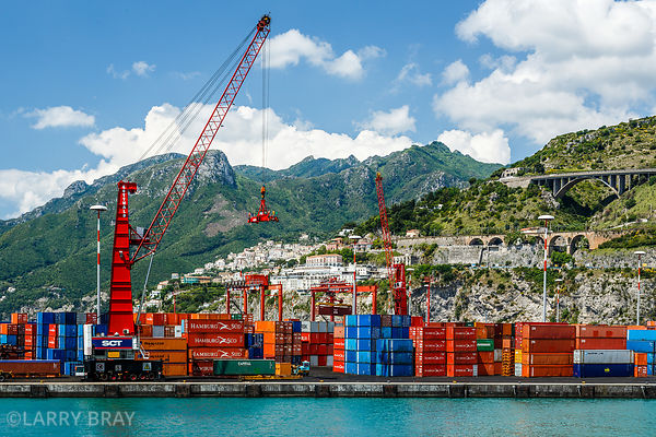 Industrial containers and cranes with city and mountains as a backdrop, Salerno harbour, Italy