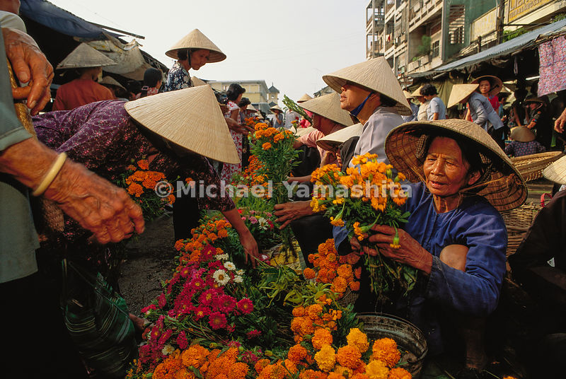 "The Cantho Flower Market is busiest during the Vietnamese New Year celebration of Tet. ""As to the four seasons, they take the..."