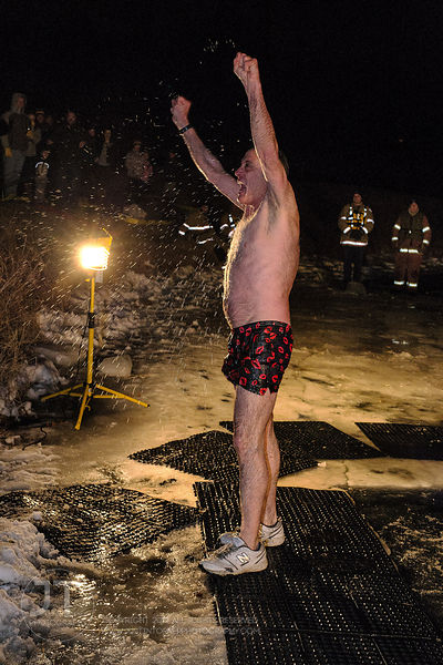 Brad Lester leaves the frigid water during the Hawkeye Wrestling Club's Polar Plunge at the Brown Deer Country Club in Coralv...