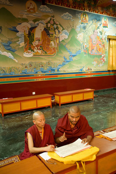 India - Sarnath - Buddhist monks reading and chanting sutras