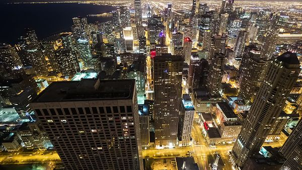 Bird's Eye: Medium Shot - High Above Lights, Streets, & the High-rises of Chicago