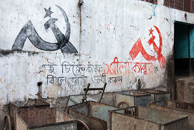 Hand-carts in front of a wall with Communist party political logos, Newmarket, Kolkata, India.