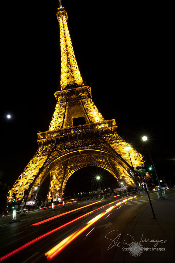 Passing Traffic and the Eiffel Tower at Night - Paris, France