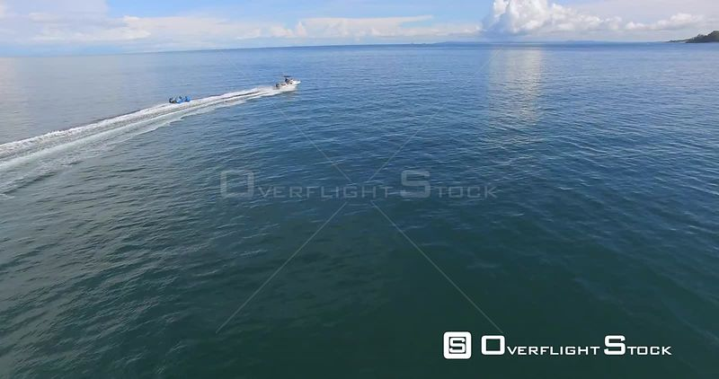 Speed Boat Towing Kids on a Raft Panama Drone Video