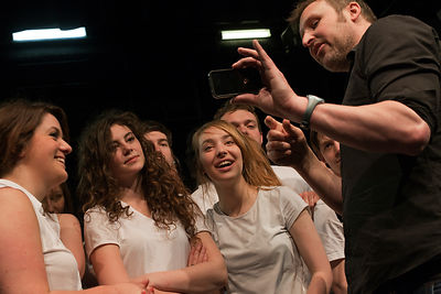UK - Hull - Director Jamie Beale shows drama students from Hull University footage of their performance on his cellphone duri...