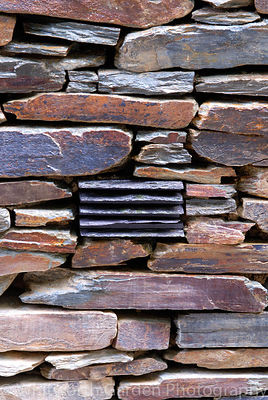 "Detail of a decorative slate inlay to a stone wall in ""A Cornish Oasis"" garden, RHS Chelsea Flower Show. © Rob Whitworth"