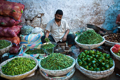 India - Delhi - A vegetable seller in the market in Mehrauli