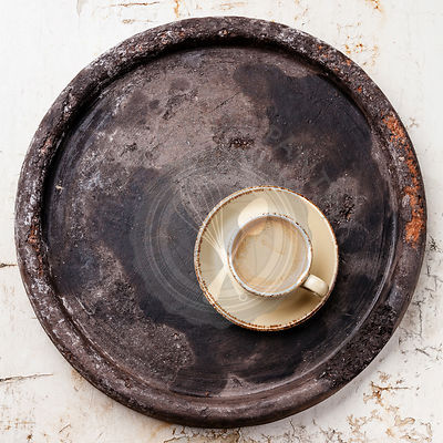Coffee cup on dark stone tray