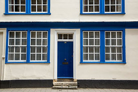 A blue front door and windows in Oxford, UK.