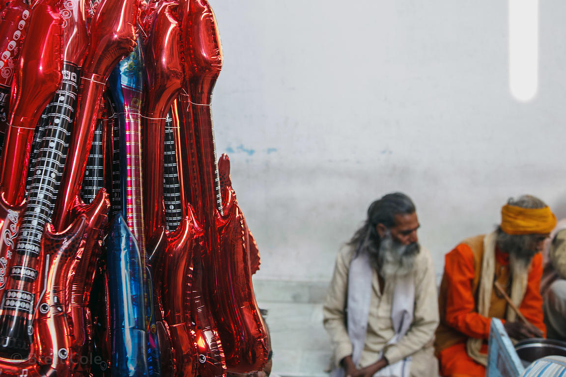 Inflateable toy guitars for sale at a tourist market in Pushkar, India.