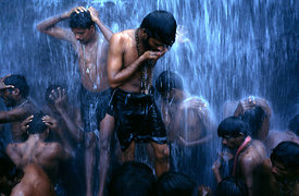 India - Tamil Nadu - Shiva devotees ritually bathe under a waterfall