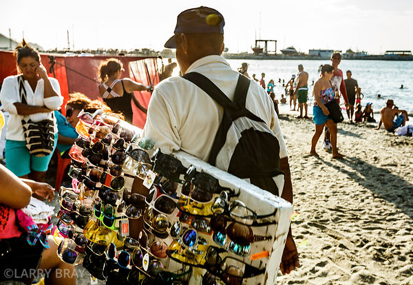 Sunglass seller on the beach in Santa Marta, Columbia, South America