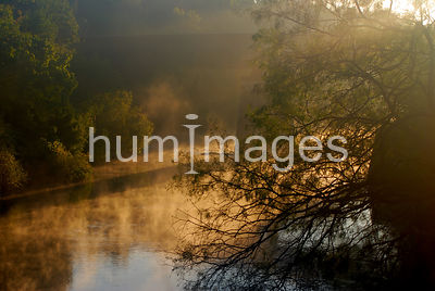 Foggy morning at sunrise on the Trinity River (with railroad bridge)
