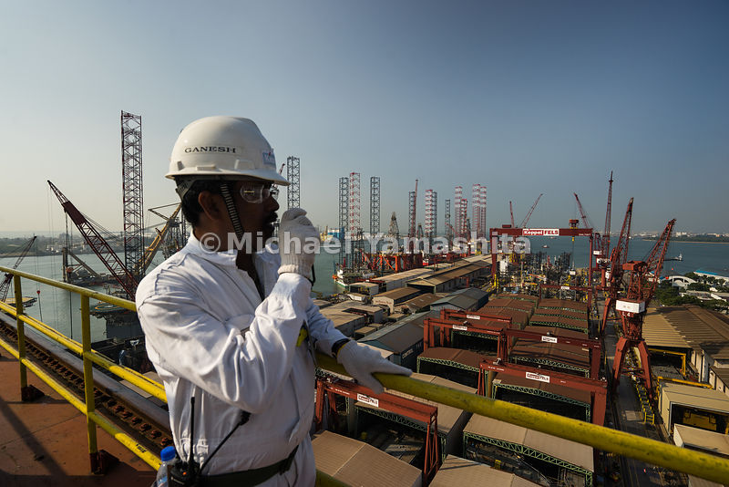 Ganesh Kumar, Assistant Shipwright Manager of Keppel FELS, relays his instructions over a walkie-talkie at the top of a 700 t...