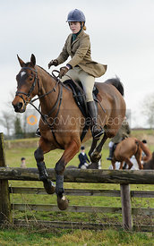 Harriet Gibson jumping a hunt jump at Windmill Farm - The Cottesmore Hunt at Bleak House