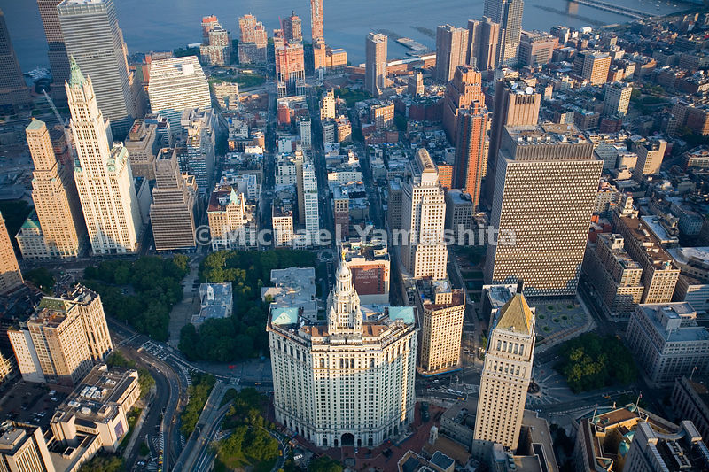 An aerial view of Civic Center in Lower Manhattan.  The Municipal Building is in the center.  The U.S. Courthouse, with a pyr...