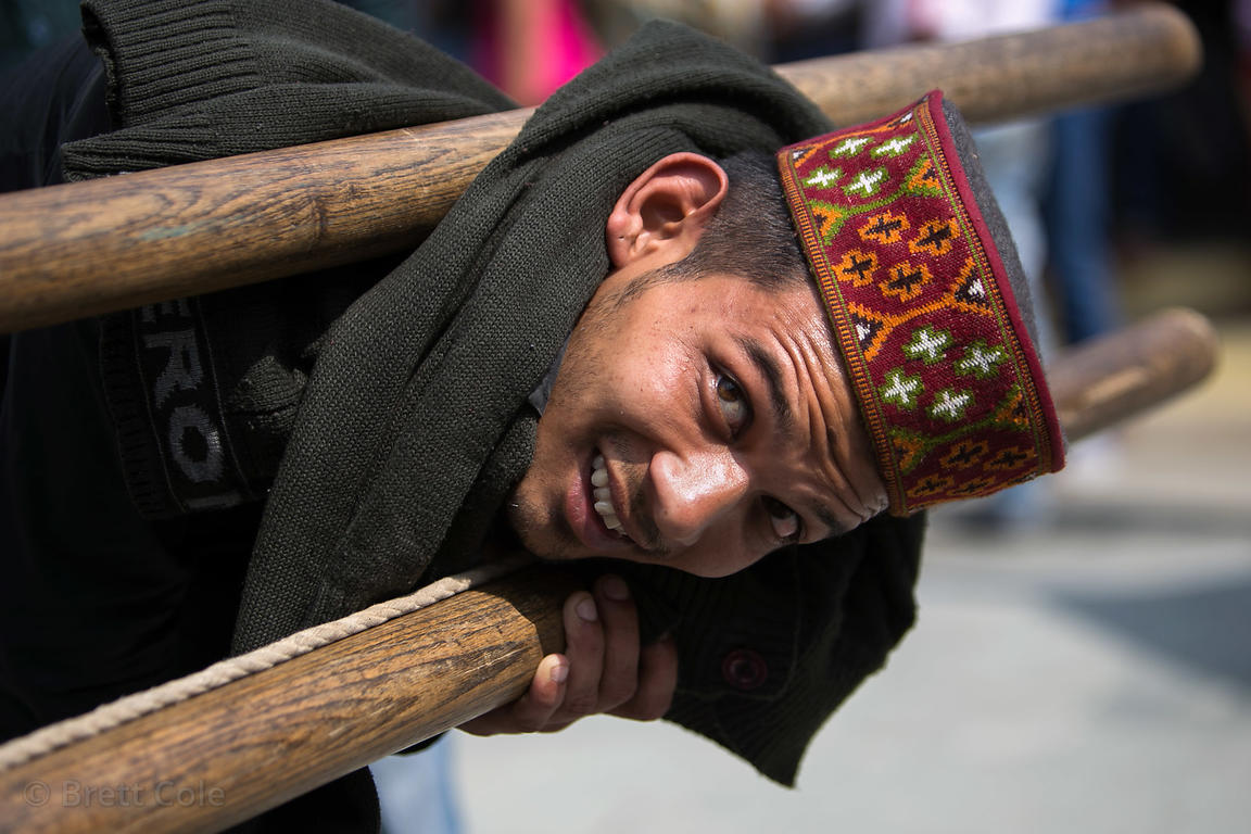 A man carries an idol during the Dussehra festival in Kullu India