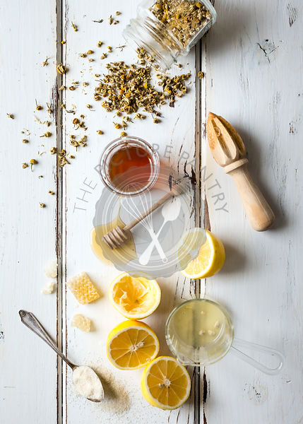 Honey and lemon ingredients on a vintage wooden board