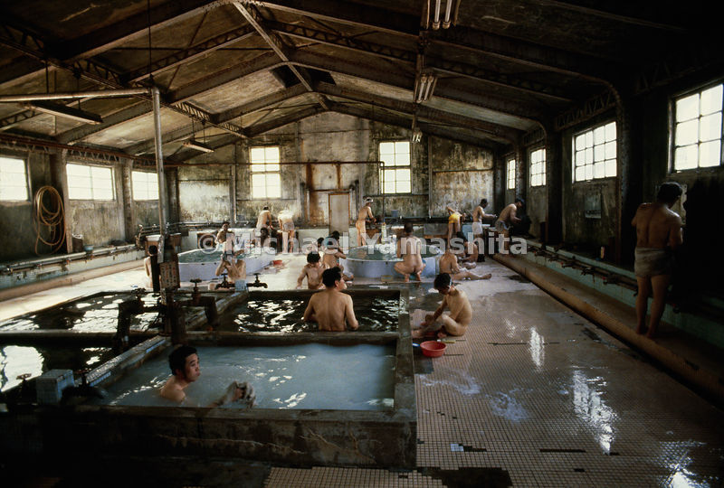 In company baths miners soap and rinse, as Japanese etiquette demands, before soaking in hot water pools.