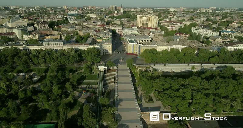 Aerial camera flies high above the Potemkin Stairs in Odessa Ukraine before tilting towards the Duc Richelieu statue on Prymo...