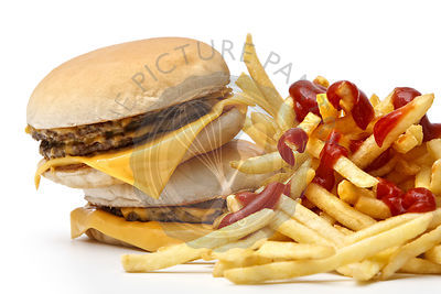 Lunch time with cheeseburger and french fries on white background Close-up