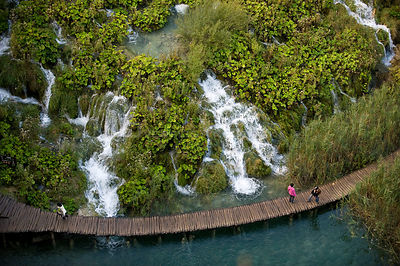 People on walkway at Velike kaskade, viewed  from above, Lower lakes, Plitvice Lakes National park, Croatia, October 2008