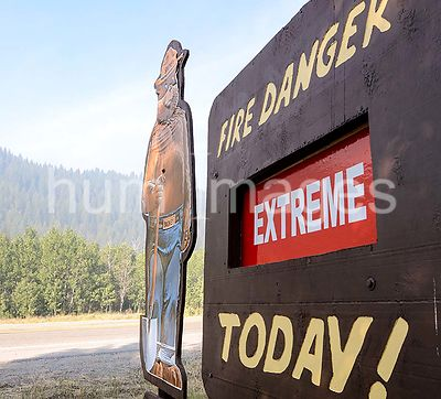 "A road side Smokey Bear sign continues to tell motorists that the fire conditions are ""Extreme"" today, during the Beaver Cree..."