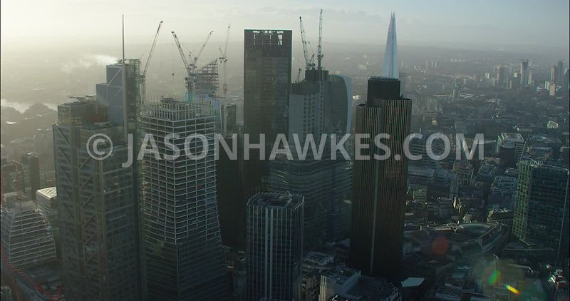 London Aerial footage, City of London skyline with Heron Tower towards The Shard.