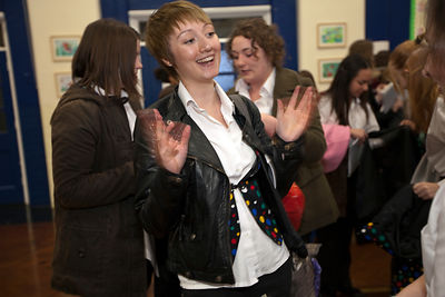 UK - Scunthorpe - Schoolgirls giggle and chatter after auditions for Cyle Song at Henderson Avenue Primary School