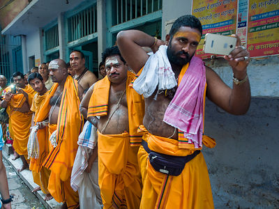Monks get ready before a procession in Varanasi