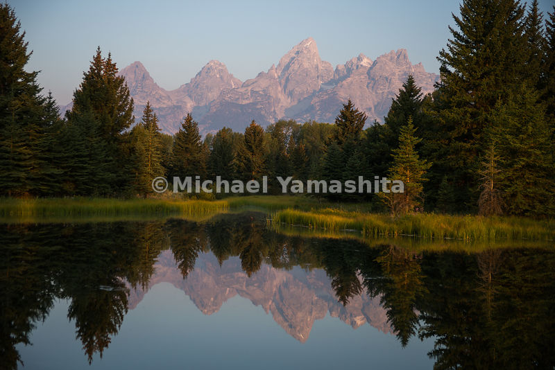 Sunrise view of the Teton Range and Snake Rier from Schwabacher landing. Grand Teton National Park, Wyoming...Jagged peaks of...