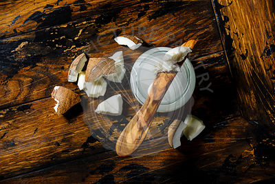 Organic healthy Coconut butter and fresh coconut pieces on wooden background