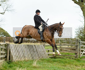 jumping a hunt jump near Peake's. The Cottesmore Hunt at Somerby