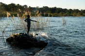 Boy fishing, Chintheche, Malawi