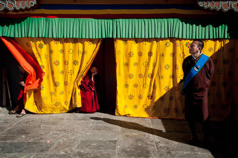 Young monks try to get a glimpse of the performances during the Thimphu festival.