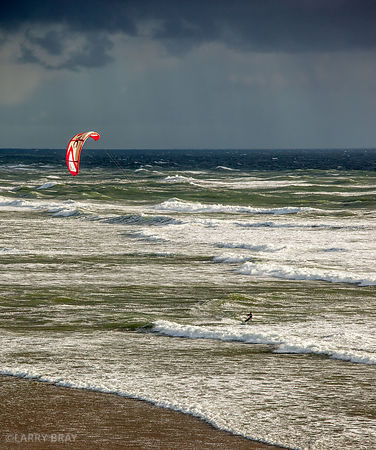 Kite surfer with stormy skies at Ocean Beach, San Francisco, USA