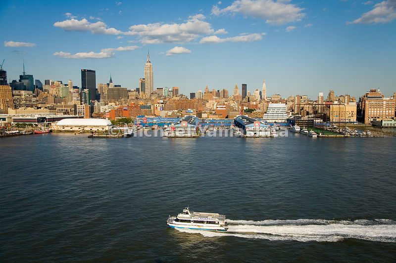 A view of the Hudson River and Chelsea Piers with Manhattan in background.